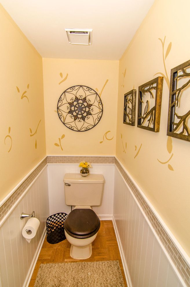 small bathroom with wall arts two piece toilet beige concrete walls ...