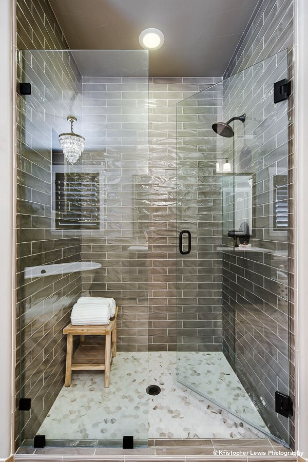 Green Glass Tiles Carve Out A Stunning Shower In This Luxurious Master  Bathroom. A Sleek Glass Panel And Door Enclose The Shower, Ensuring The  Bathroom ...
