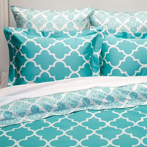 Turquoise bedding and pillows. More bedroom decor ideas @BrightNest Blog