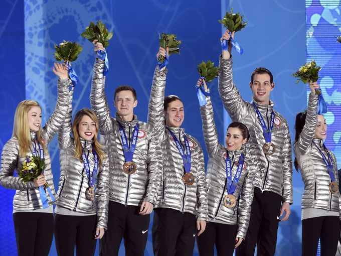 Team USA poses with their bronze medals in the team figure skating competition.
