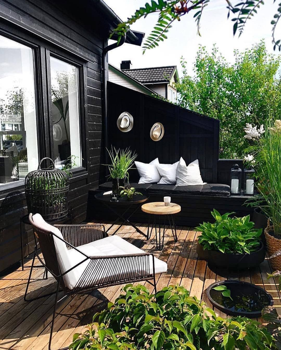 I Ve Always Liked Black In Nature I Feel Like There Is A Something So Sleek When You Combine Black Wood And Greenery Summer Living Home Outdoor Rooms