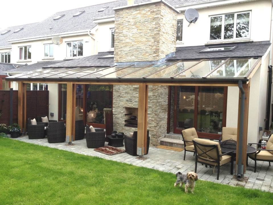 About New Traditional Style Extension With Glass Covered Pergola