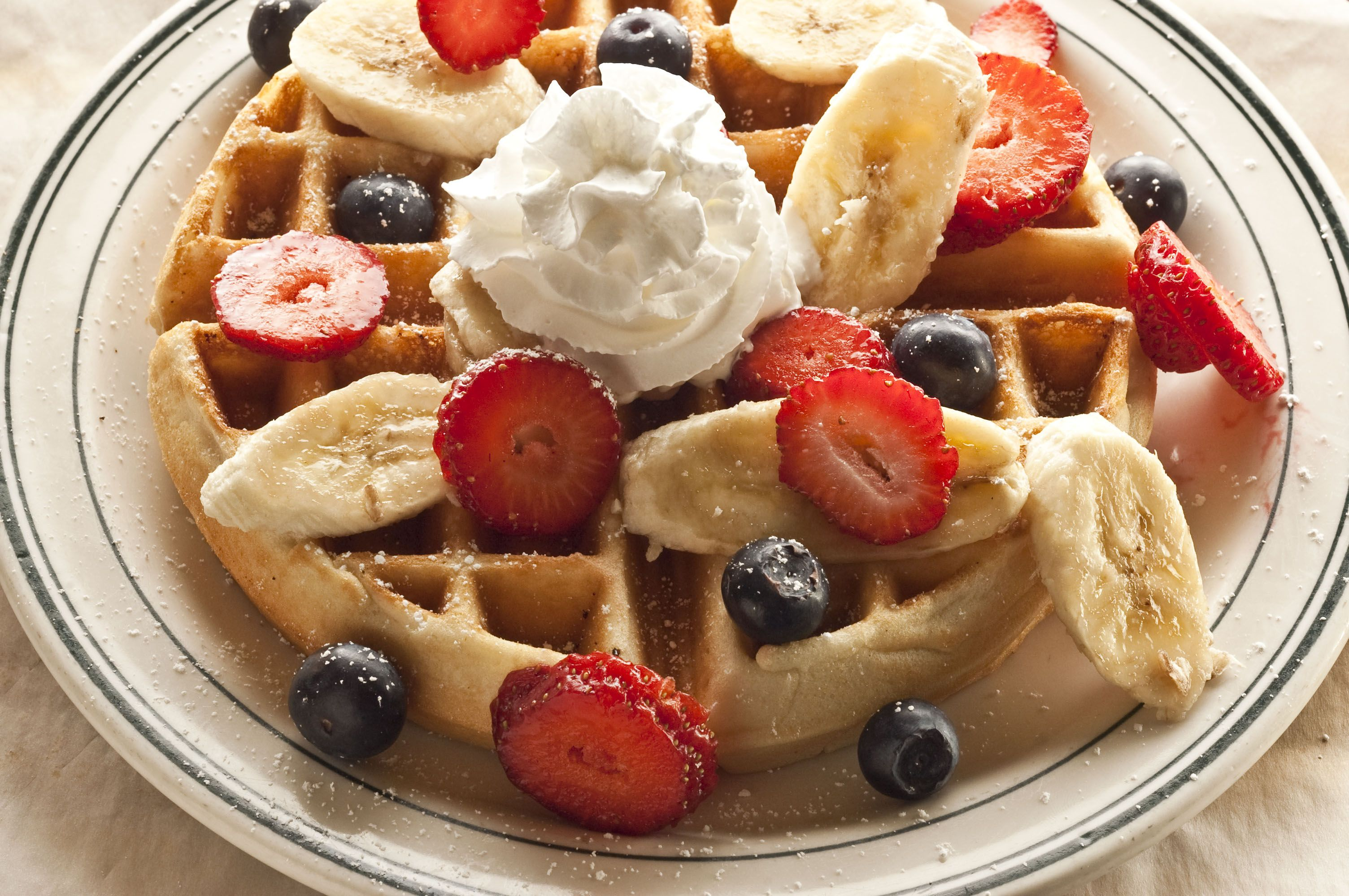 Waffle with fresh fruit and whipped cream