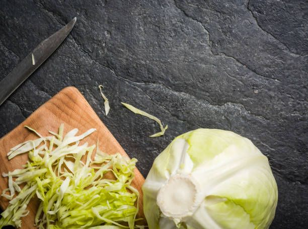 chopped cabbage on a black stone background