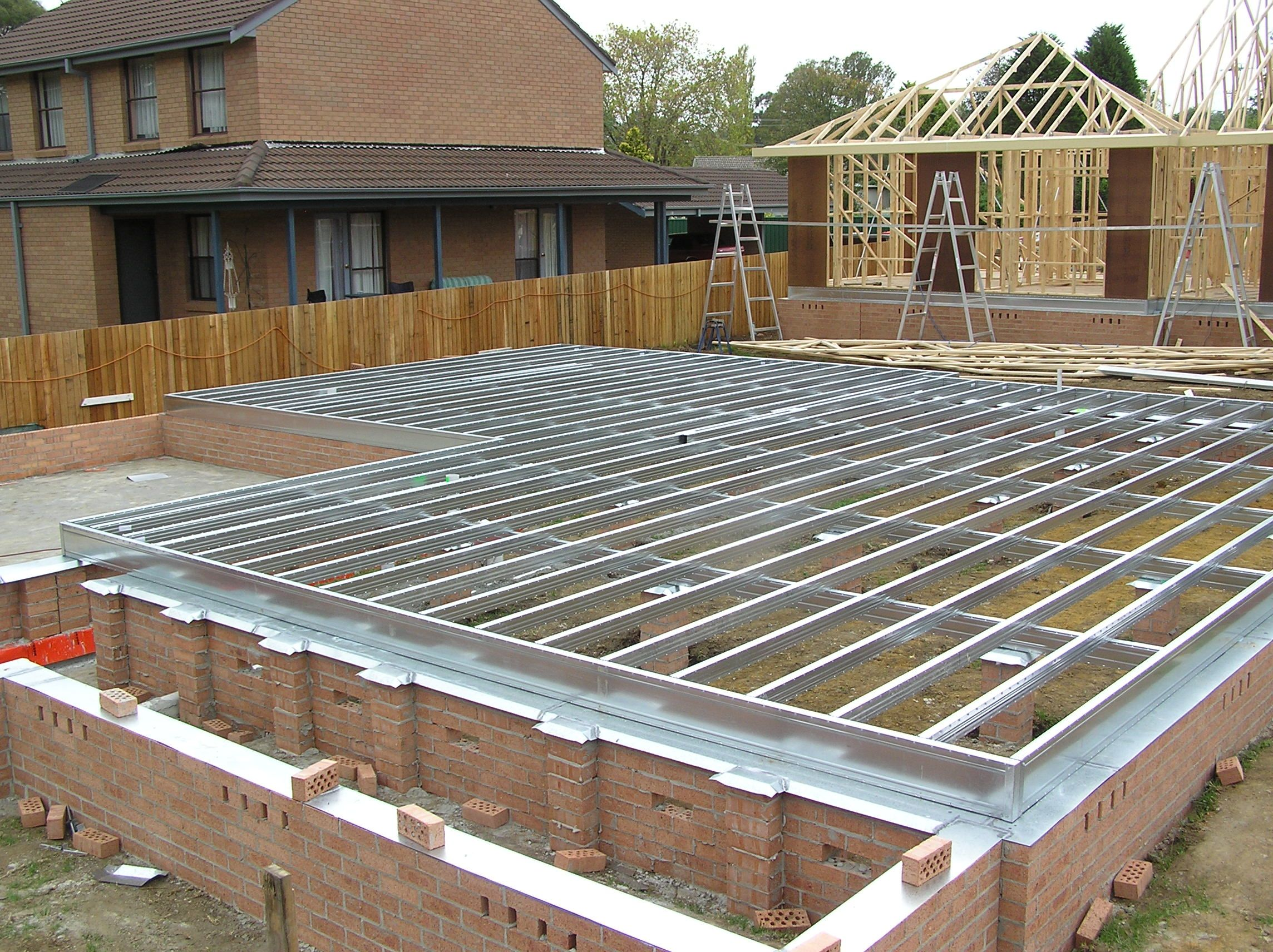 Spantec steel ground floor on fully engaged and isolated Metal piers for housing