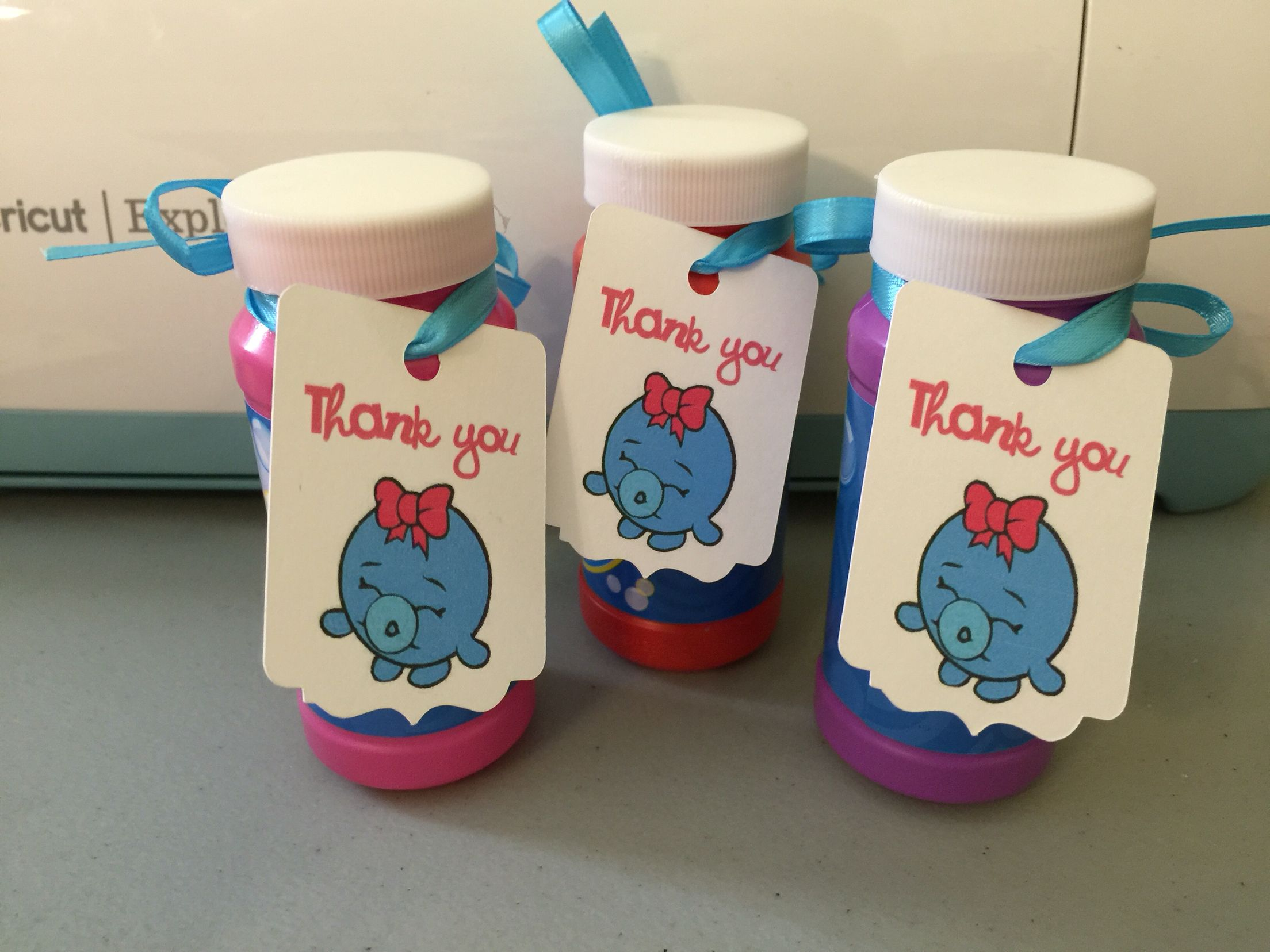 """Bubbles"" the Shopkins Character on a ""Thank You"" tag attached to a bottle of bubbles for party favors."