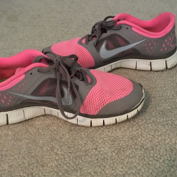 Nike Free Runs Women's. Worn but still in good condition. Scuffed slightly only toes & dirt from wear. Really comfy and super cute. Size 10 Nike Shoes Athletic Shoes