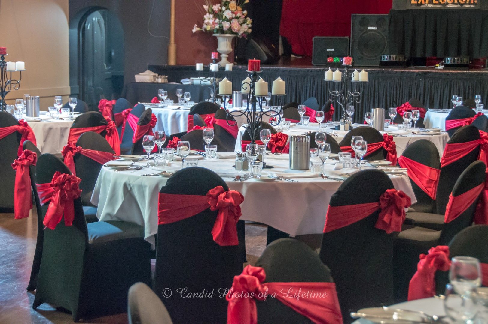 black lifetime chair covers office with adjustable arms wedding photographer candid photos of a reception table set up red white theme cloths