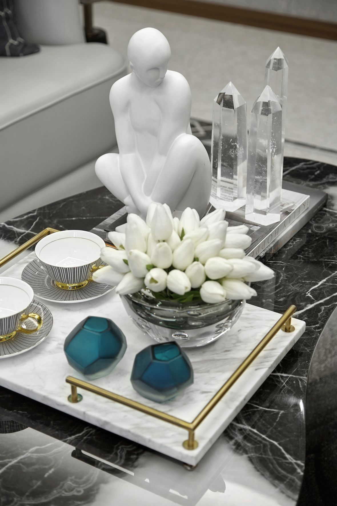 A Formal Tablescape On Coffee Table W Black Marble Top