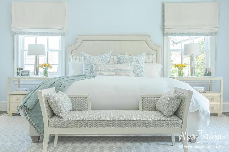 Ivory And Pale Blue Bedroom Features A Pale Blue Wall Lined With An Ivory Bed With Silver Nailhead Tr Blue Master Bedroom Pale Blue Bedrooms Light Blue Bedroom