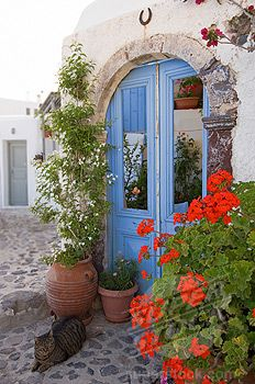 Oia, Santorini. Arched doorway with flowers.