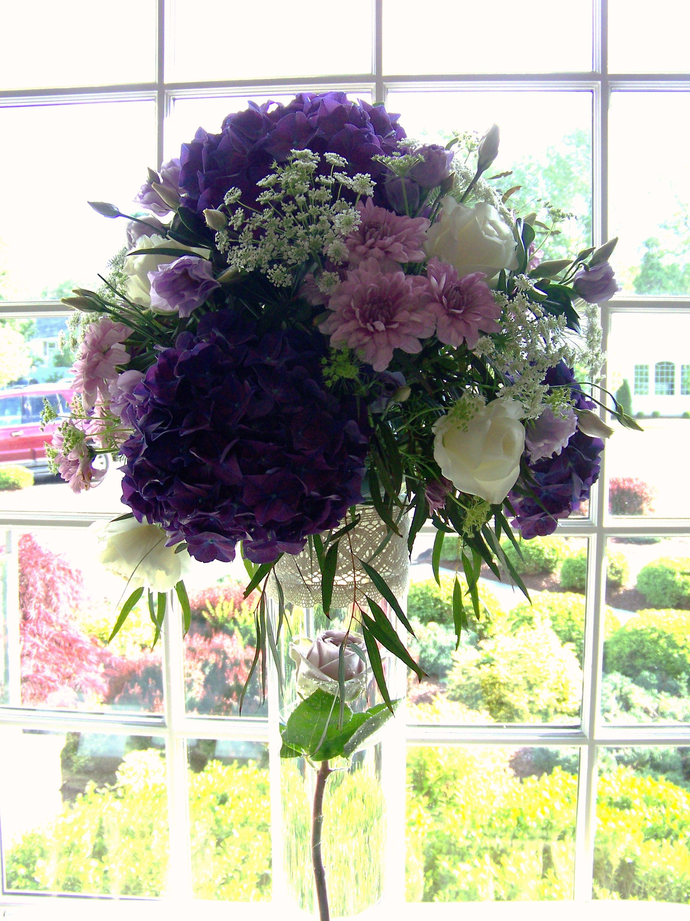 Tall Placecard Table Centerpiece With Purple And White Flowers