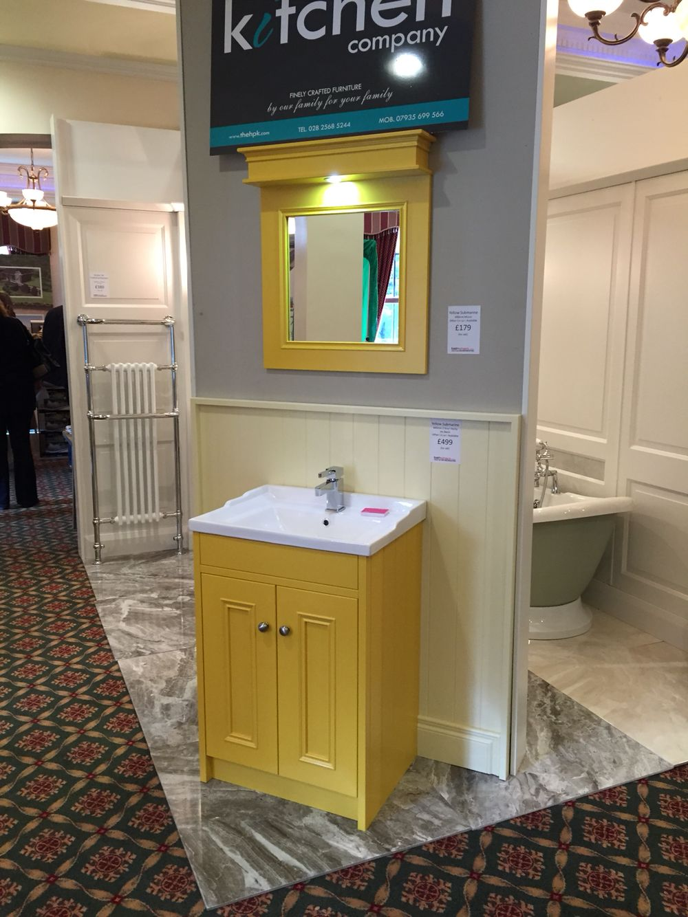 Yellow painted bathroom vanity unit with matching painted mirror
