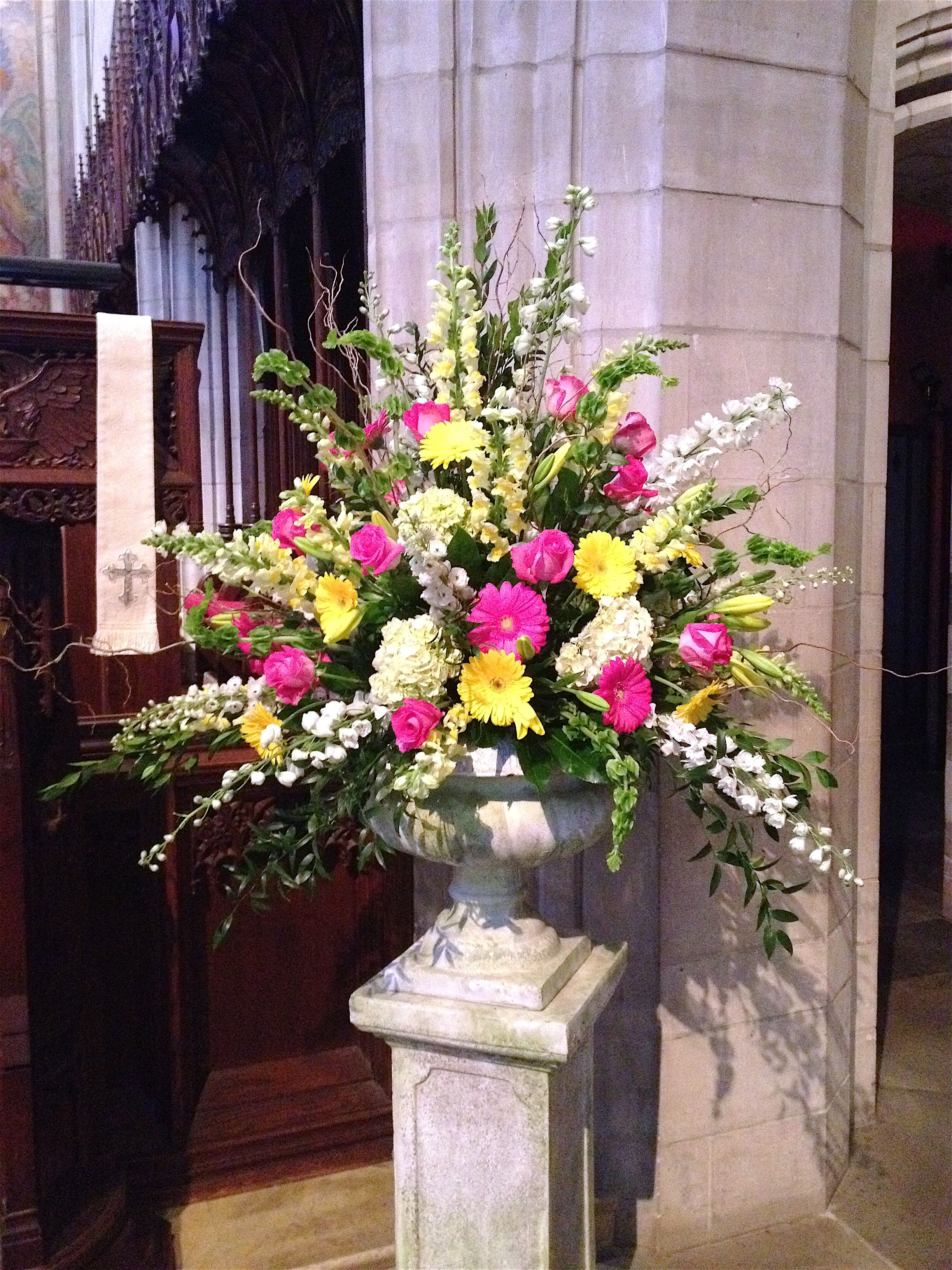 A pedestal from a spring wedding, in jewel coloured