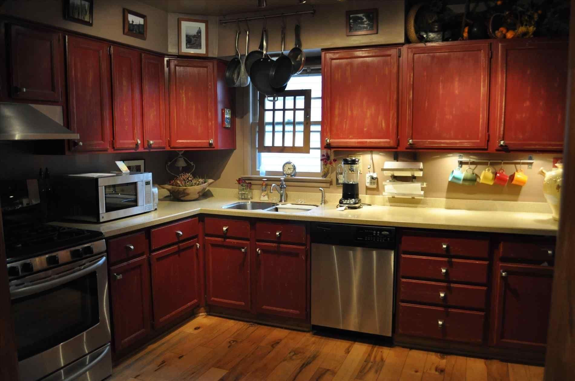 Red Kitchen Floor Tiles Kitchendesign Kitchenremodel Kitchen Wood Kitchen Cabinets Distressed Kitchen Cabinets Cherry Wood Kitchen Cabinets