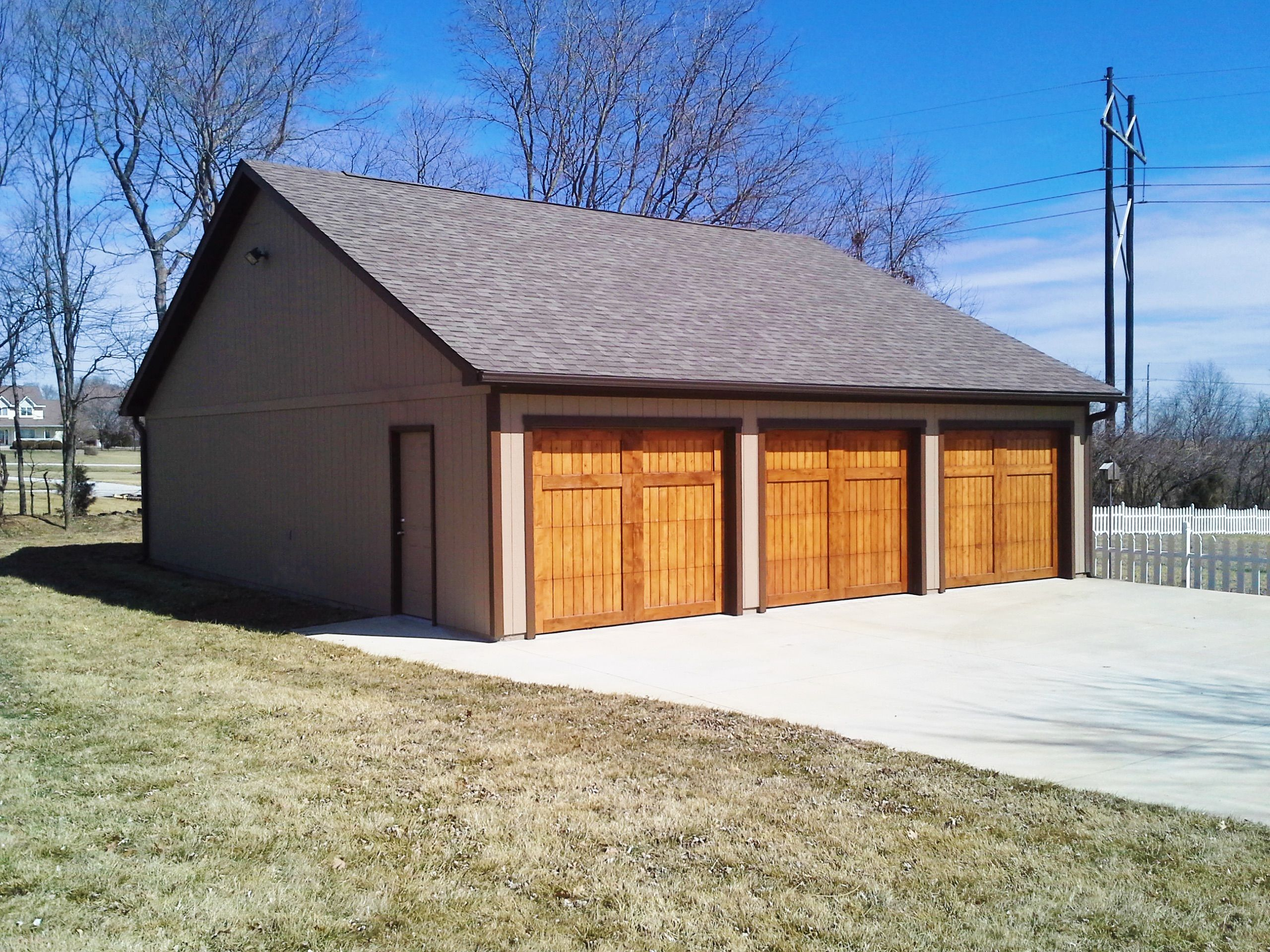 These wood doors are a great addition to a three bay garage. | Tuff ...