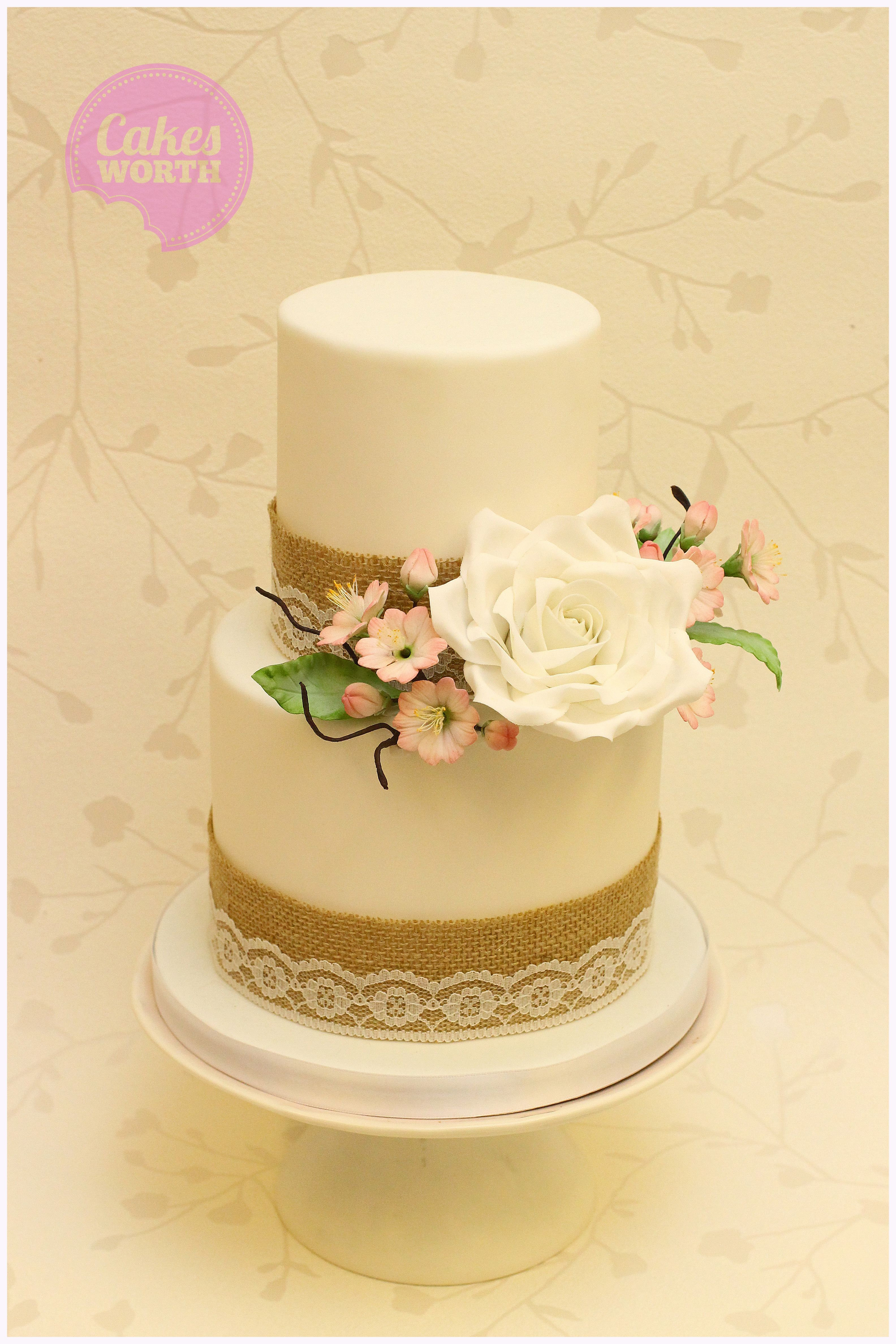 Rustic wedding cake with large handmade white sugar rose and soft ...