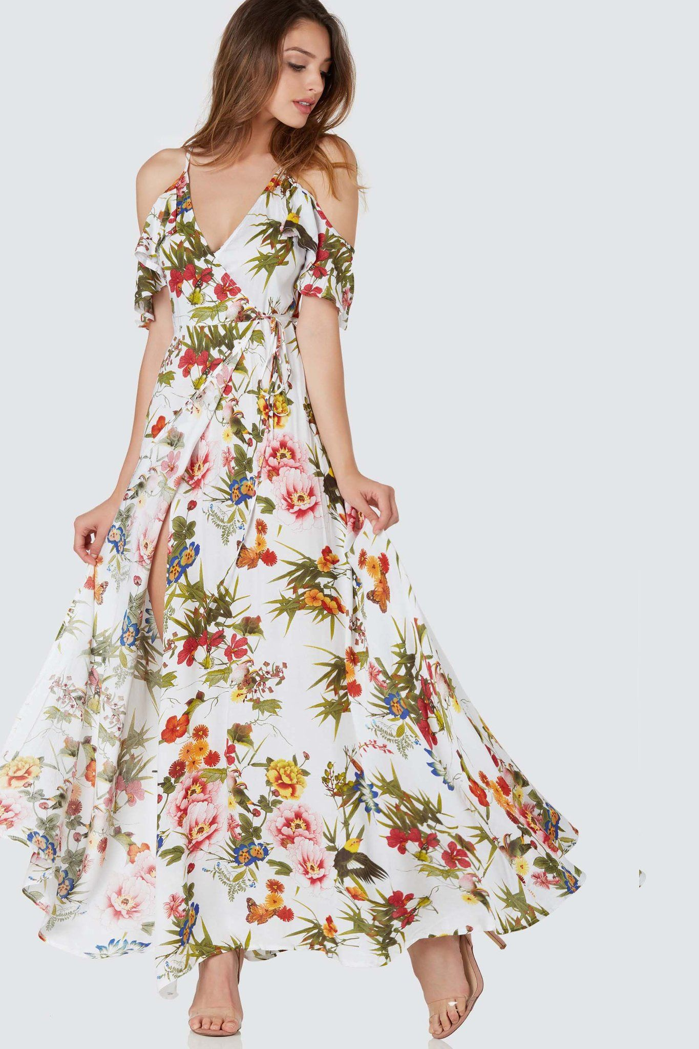 Flowy cold shoulder maxi dress with colorful floral patterns ...