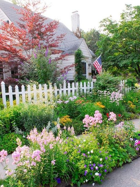Front yard landscapes white picket fence pretty flowers and fences pinterest white picket fence with flowers white picket fenceetty flower borders gardens mightylinksfo