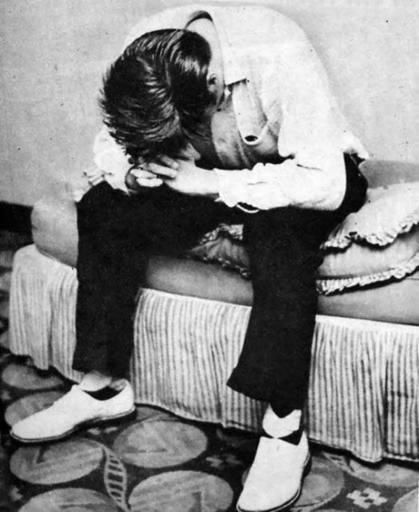 Elvis, Miami, FL 1956; between shows. The evening show was cut short when crazed fans rushed the stage and Elvis' clothes were completely torn off.