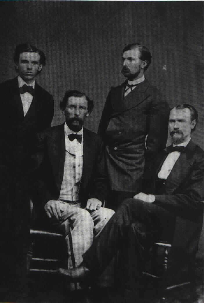This photo was taken around Christmas time at Fort Stanton, New Mexico Territory in 1871. The men are, from left to right: J. J. Dolan, Emil Fritz, W. W. Martin (the clerk of the Fort Stanton store), and L. G. Murphy.