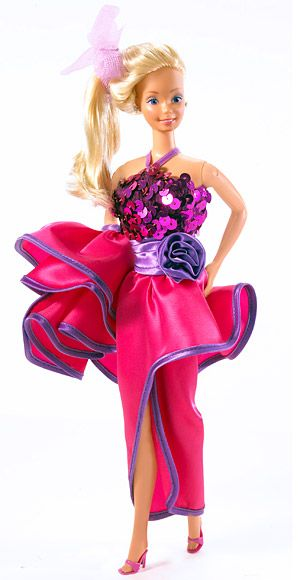 Dream Date Barbie, 1983  Dream Date Barbie dazzled Ken in her pink sequined peplum gown...OMG I used to love her!!!!!!