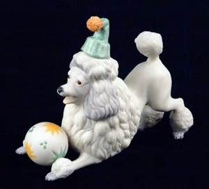 White porcelain poodle with hat and ball
