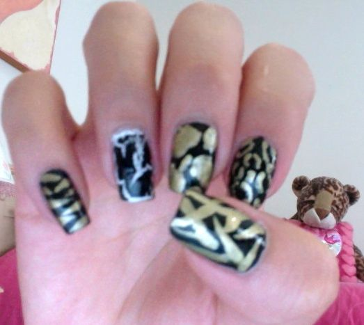 My nails... #Currently can you see my inspiration to my index finger? it's right behind!! XD