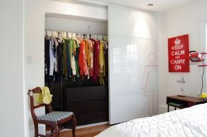 Pax Tonnes sliding doors by Ikea for closet solution by Biner