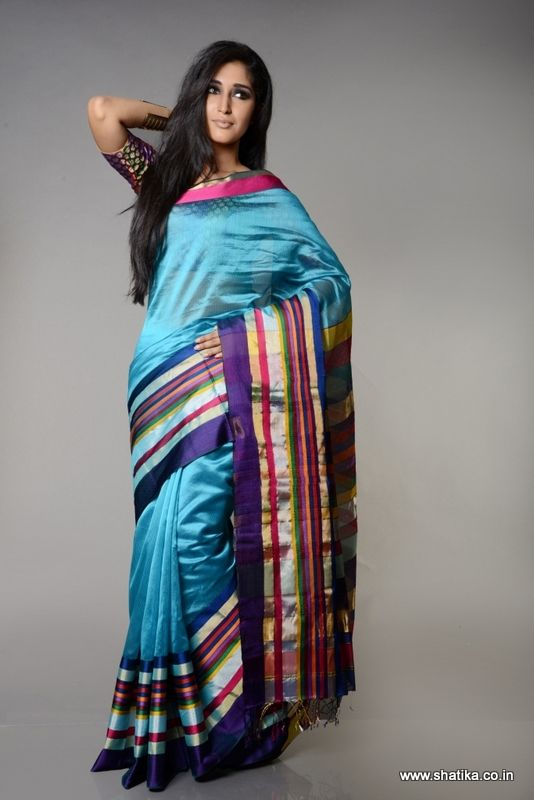 88ec43d88208b Sprightly blue in a glossy finish teamed with multicolor stripes along the  body and pallu of the saree