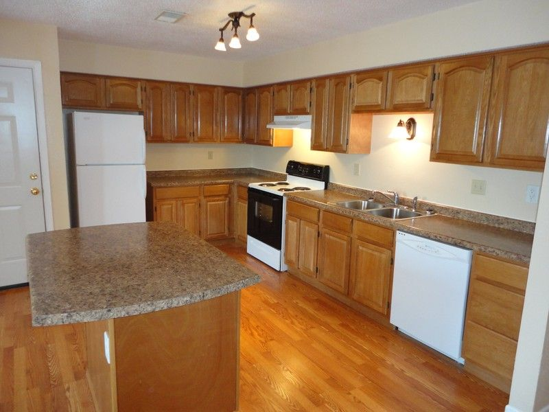 Hardwood Kitchen Floors Wood Cabinets Off Color Brown Countertops White Appliances