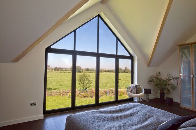 Triangle Folding Doors : Internal view of pane bifold door with gable frame above
