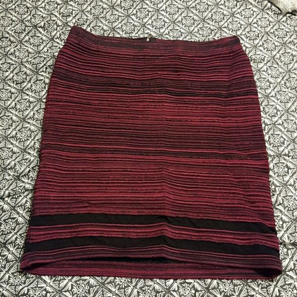 Preloved Jessica Simpson bandage skirt Worn once! Very form fitting. More of a dark maroon than a dark red. Mesh stripes at bottom and zipper back. Jessica Simpson Skirts Pencil