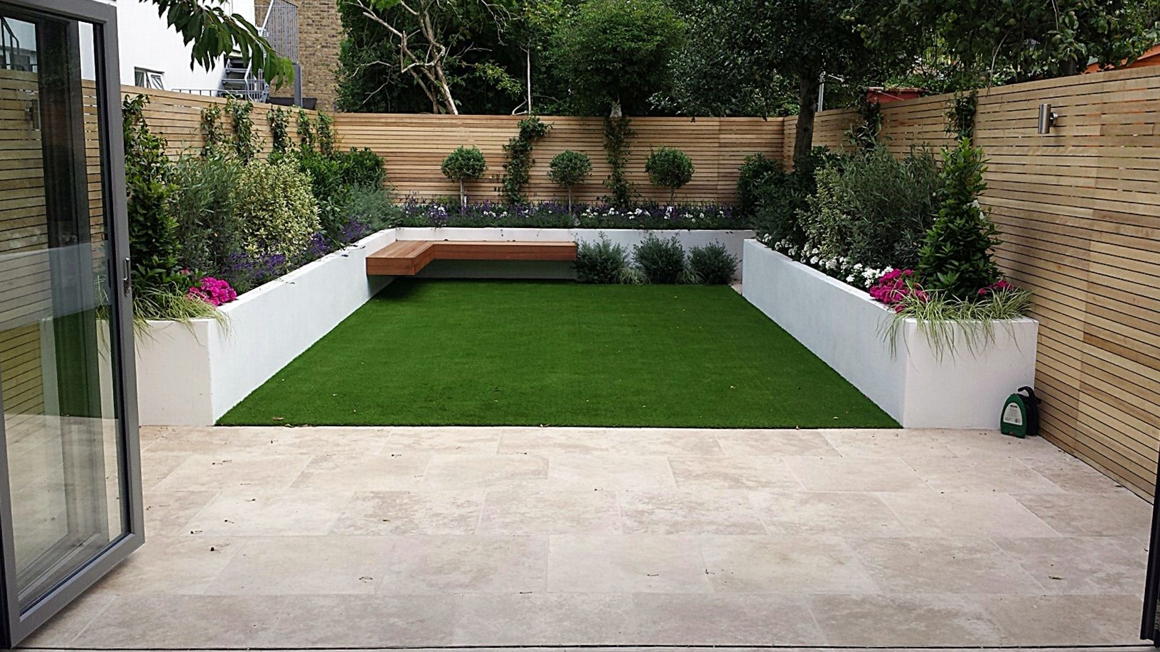 Travertine paving patio render block raised beds hardwood floating bench cedar slatted privacy - Stone fences garden designs ...