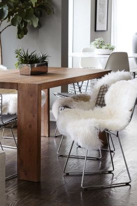 Homepolish Interior Design | The organic wood Blox Dining Table from CB2 compliments the vintage Bertoia chairs – and you really can't go wrong with a well-draped sheepskin.