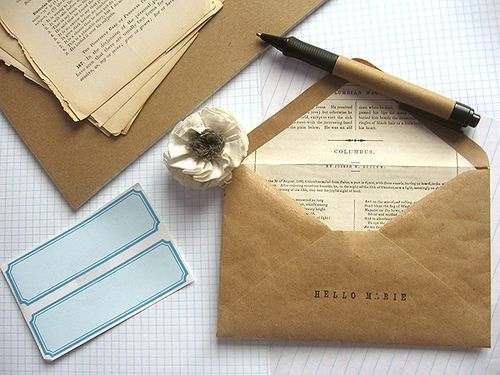 Craft paper envelopes with book page liners.