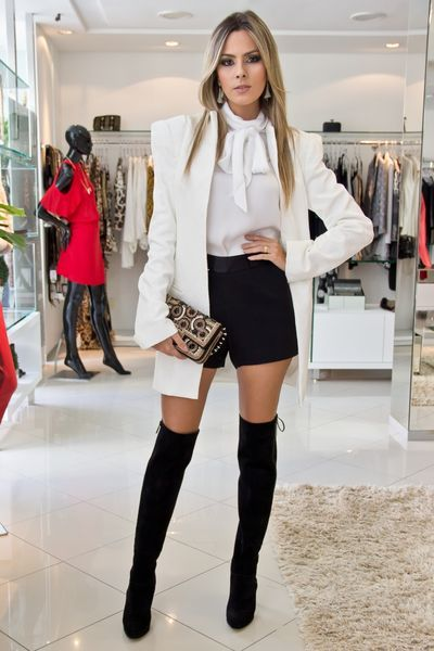 60e2b14e245 White top with off white jacket and black shorts with black thigh high boots  (Fall Top Stylists)