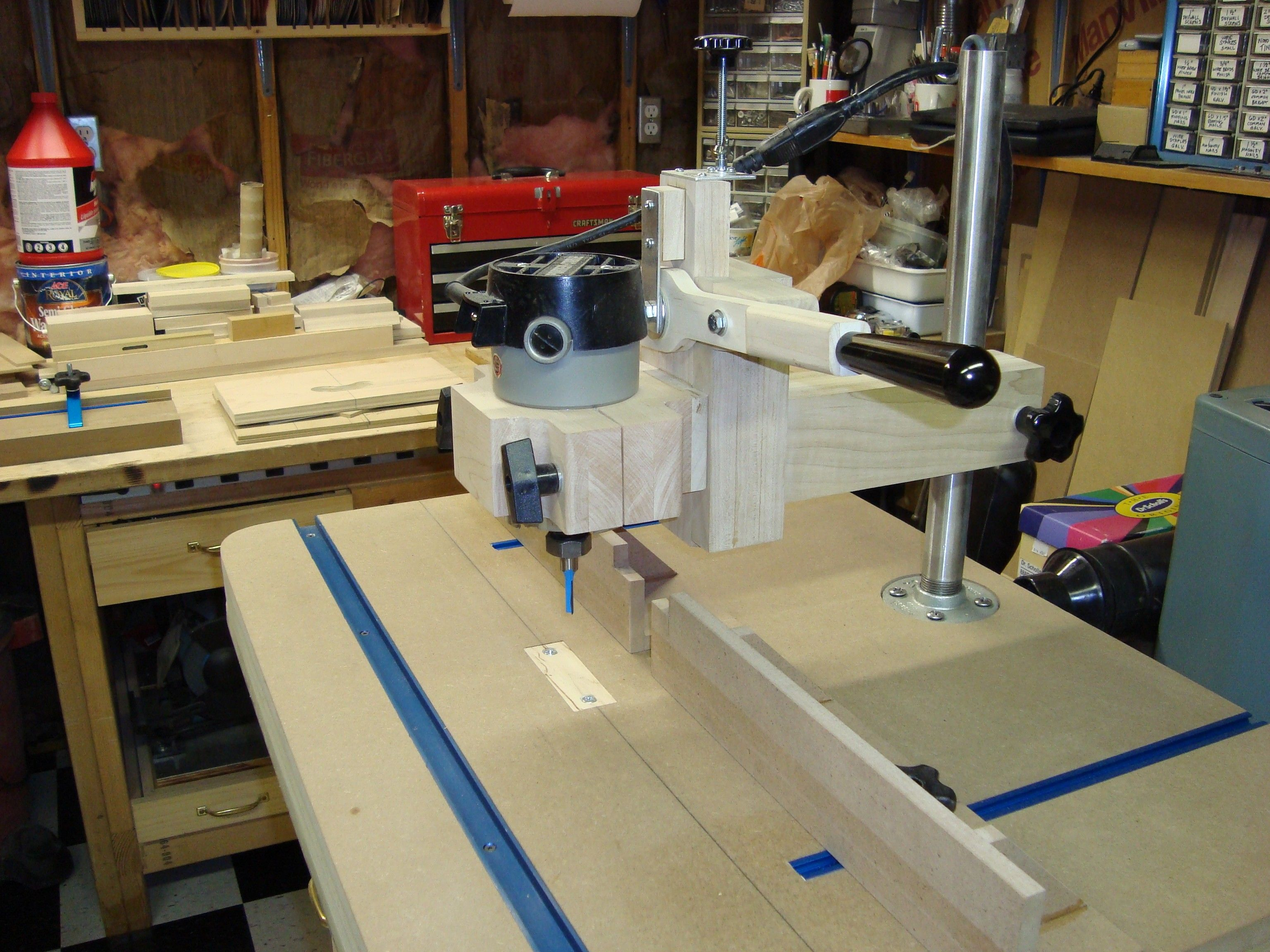 Overarm router jig using a beautifully simple lever arm and overarm router jig using a beautifully simple lever arm and dovetailed ways to lower the bit into the workpiece from above a pin in the table can follow a greentooth Gallery