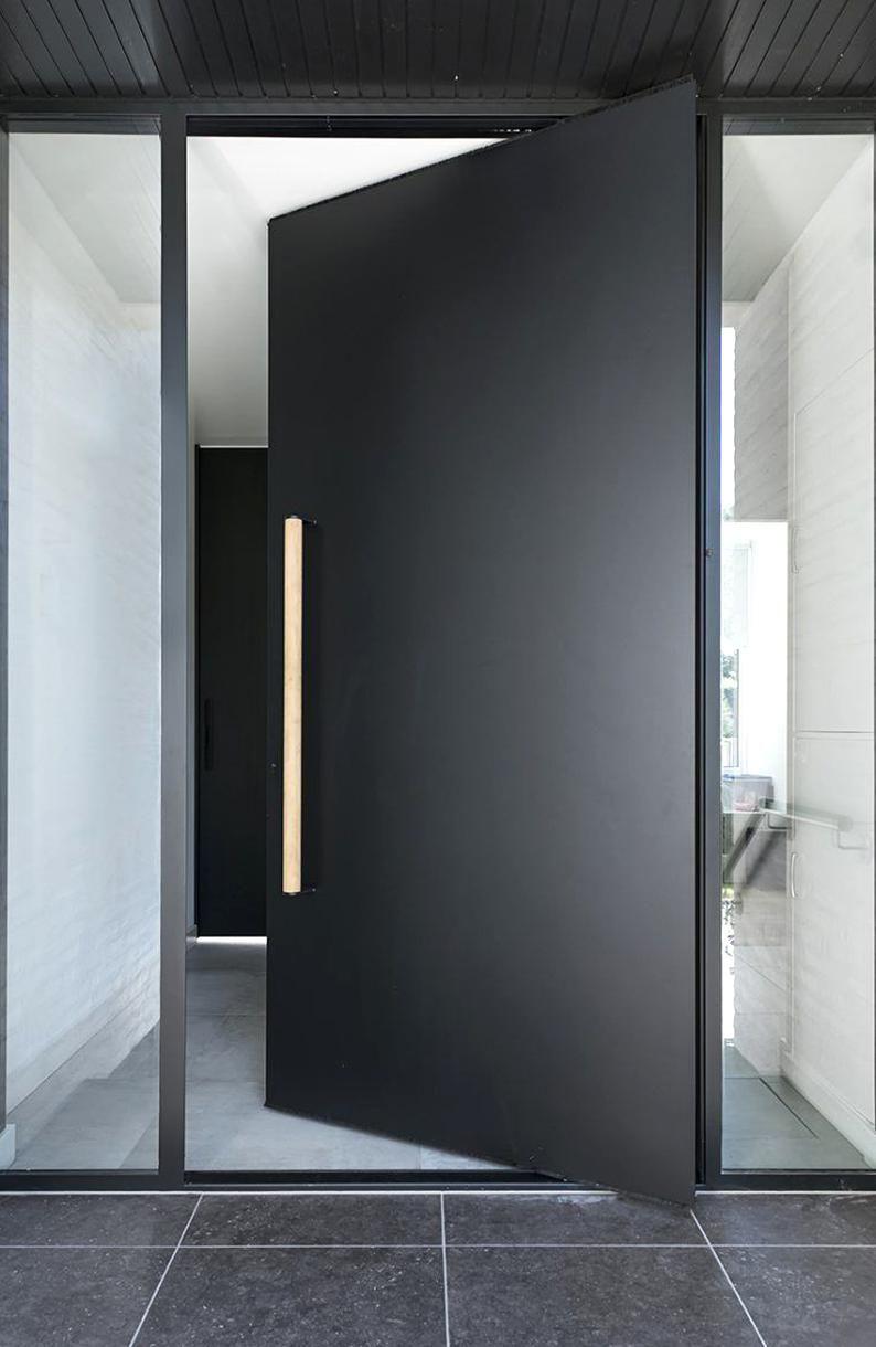Exterior pivot door in black  FritsJurgens #exterior #exterior #window
