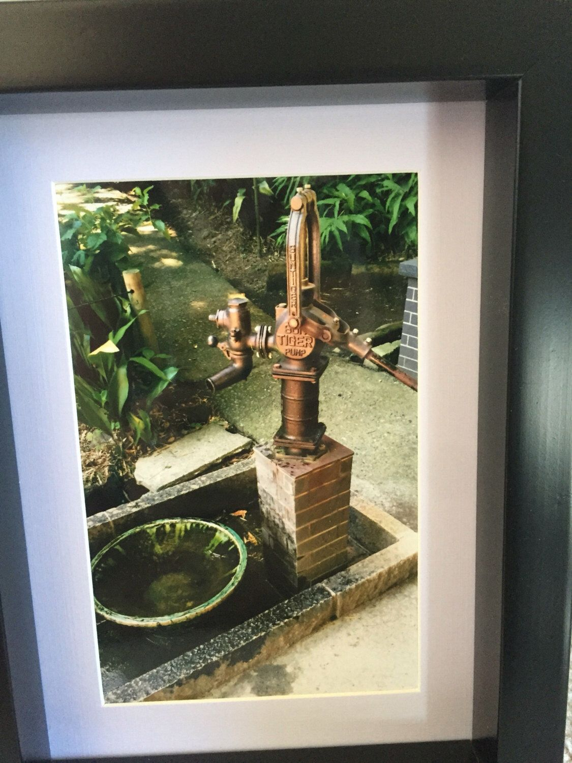 A personal favorite from my Etsy shop https://www.etsy.com/ca/listing/465568490/antique-water-pumpvintage-tokyo
