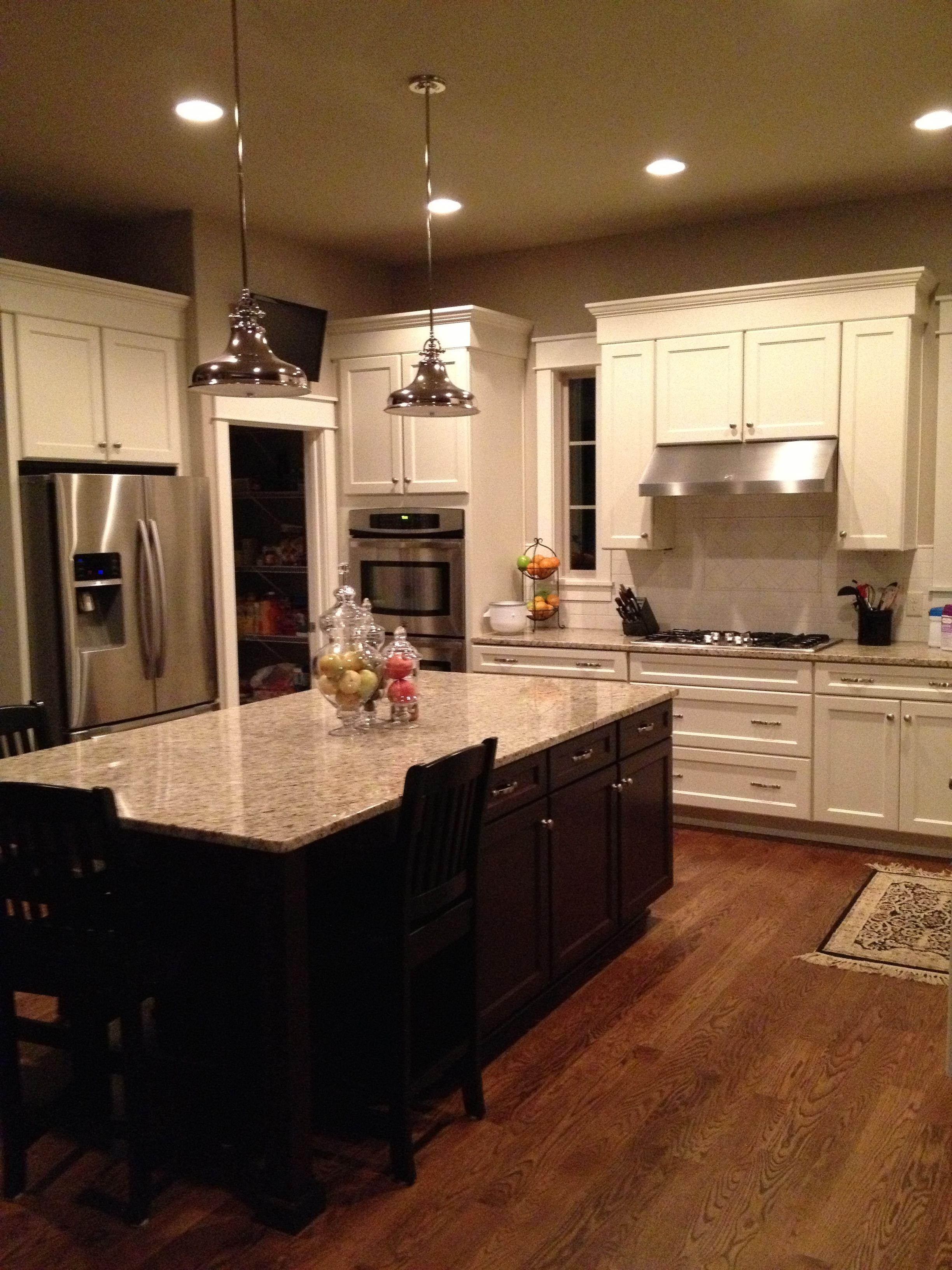 White kitchen cabinets white subway tile dark island white