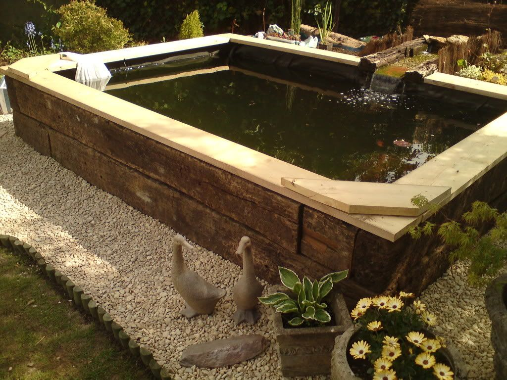 Railway sleeper pond ideas google search omg amazing for Raised koi pond ideas