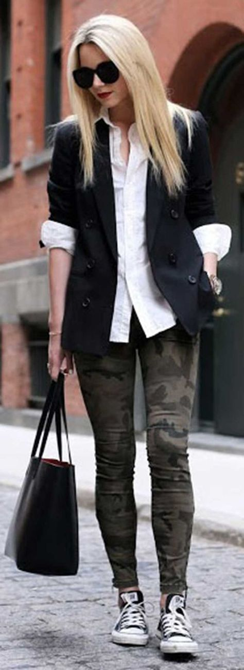A black double breasted blazer and olive camo slim jeans will give off this very sexy and chic vibe. Want to go easy on the shoe front? Choose a pair of black and white low top sneakers for the day. Shop this look on Lookastic: https://lookastic.com/women/looks/double-breasted-blazer-dress-shirt-skinny-jeans/19783 — Black Sunglasses — White Dress Shirt — Black Double Breasted Blazer — Gold Watch — Olive Camouflage Skinny Jeans — Black Leather Tote Bag — Black and White Low Top Snea...
