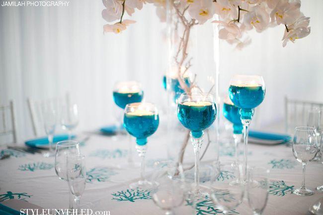 turquoise and white wedding table decor j morgan flowers jamilah photography via styleunveiled