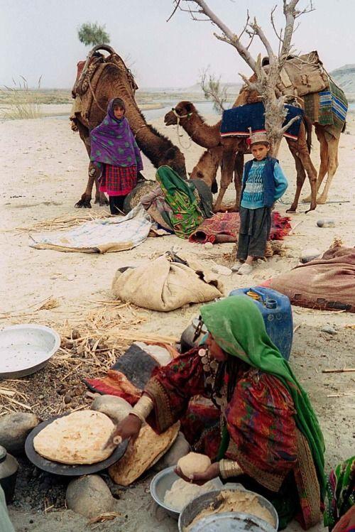 Afghanistan Nomad women (also known as Kuchis)preparing food. By:B.K.Bangash Bangash