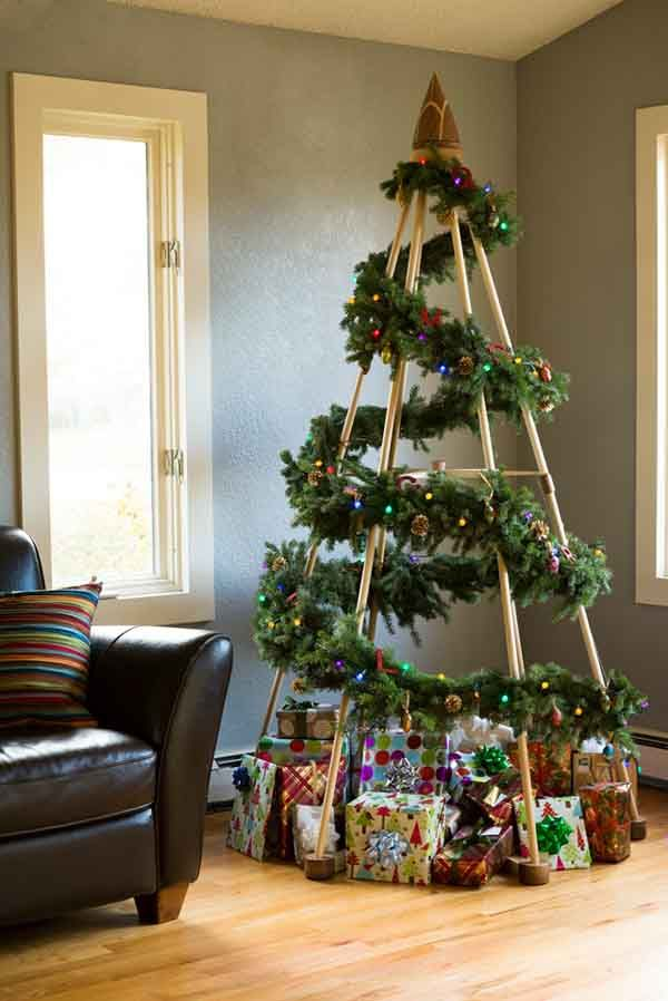 The highlight of every Christmas decoration is the Christmas tree. It feels  too empty without a tree to stack your gifts under. Children wait for Santa  on ... - Unique And Clever Alternative Christmas Trees Craft Ideas