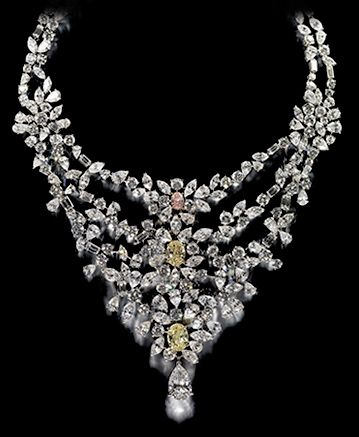 Marie Antoinette Style Necklace by De Beers.  Over 15 carats of brilliant white diamonds with two rare yellow diamonds and an exceptional pink diamond, all set in pure platinum.  Queen Marie Antoinette owned such a necklace but it disappeared in the wake of the revolution.