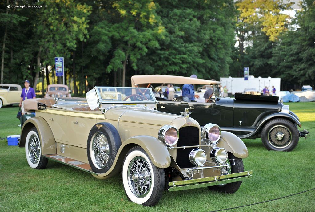 Photographs of the 1926 Duesenberg Model A. Phaeton. Coachwork by Millspaugh & Irish. Chassis number 1451. Concours d'Elegance of America at St. John's. An ...