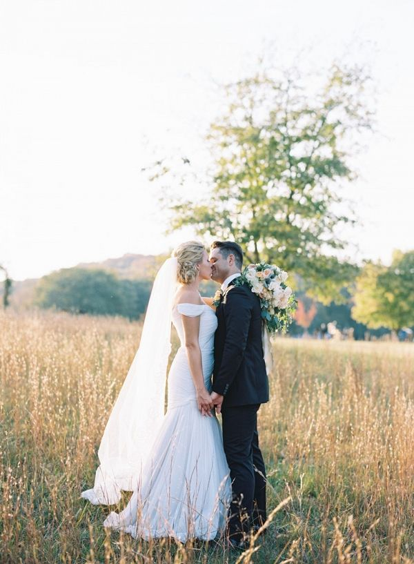 The Bride & Groom's Romantic Kiss in Golden Sunlight