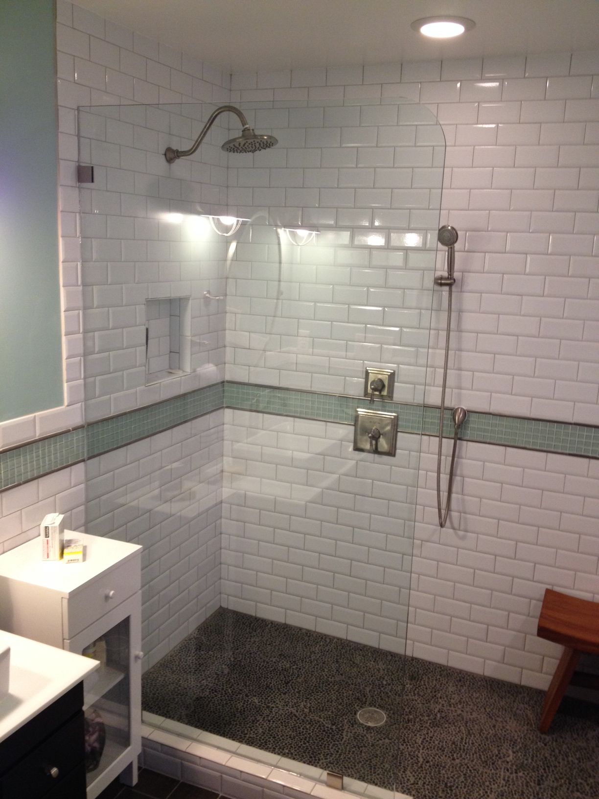 """Finished walk in shower 3 8"""" tempered glass Black pebble floor with med gray grout The small pebble floor feels very fortable on your feet"""
